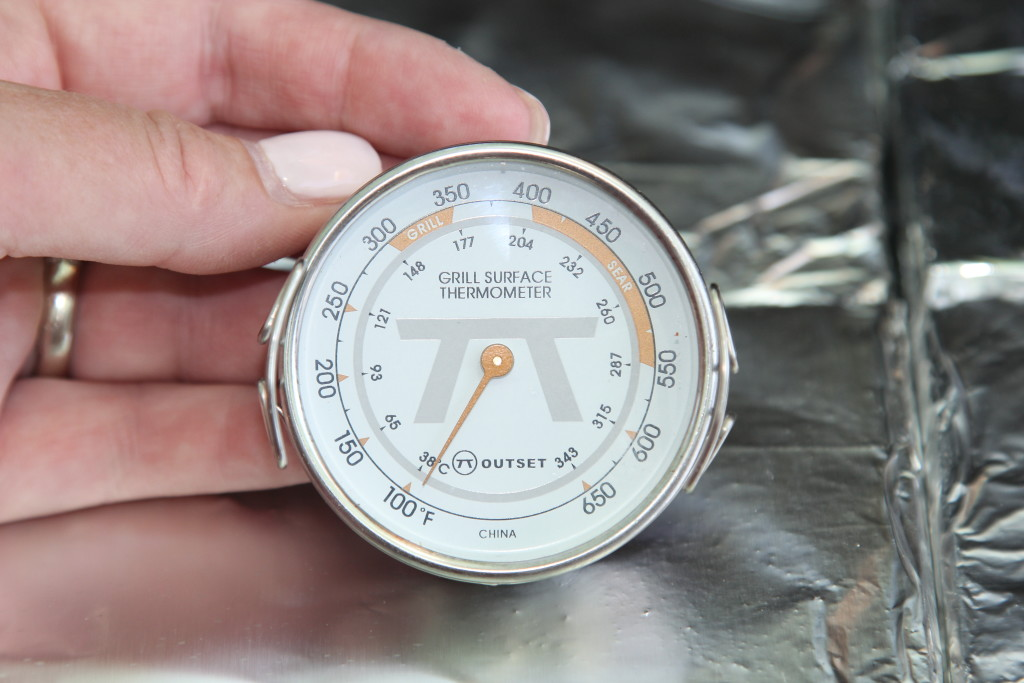 Close up of a grill surface thermometer to bake a pie on the grill
