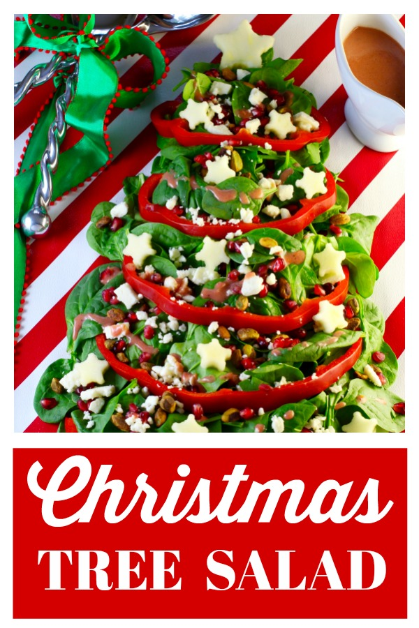 A festive, easy, healthy Christmas Tree Salad (Christmas Salad) with a Mason Jar Cranberry Vinaigrette will be the talk of your holiday or Christmas party! Serve on a holiday paper wrapped cutting board tied with a festive bow! #christmassalad #holidaysalad #christmastree #cranberryvinaigrette #Masonjarvinaigrette