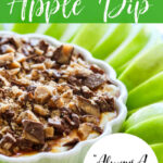 A dessert dip recipe for caramel apple dip with the dip in a white flower shaped low dish, and green apple slices around the dish.