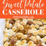 White casserole dish with sweet potato casserole topped with golden brown mini marshmallows.