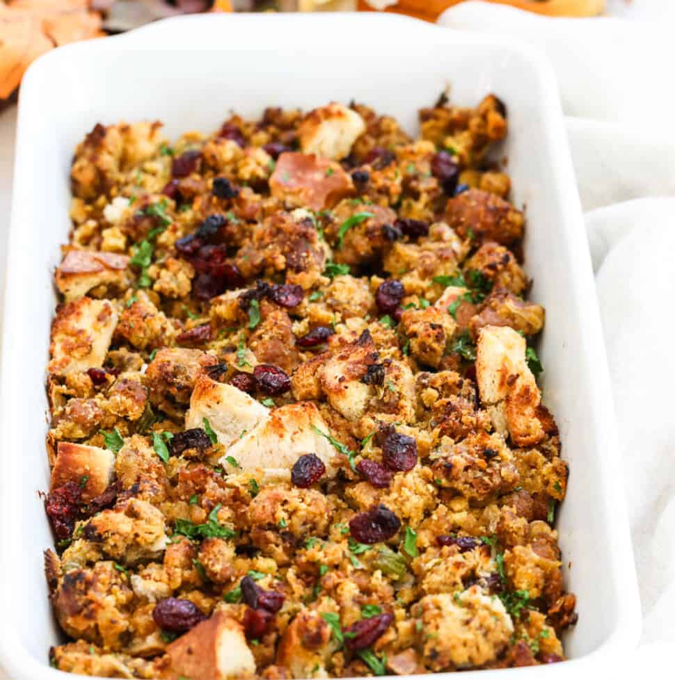 Large white casserole dish with Sausage Dressing for a Thanksgiving feast.