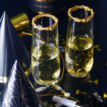A New Years Eve party with champagne cocktails made with Goldschlager gold liquor.