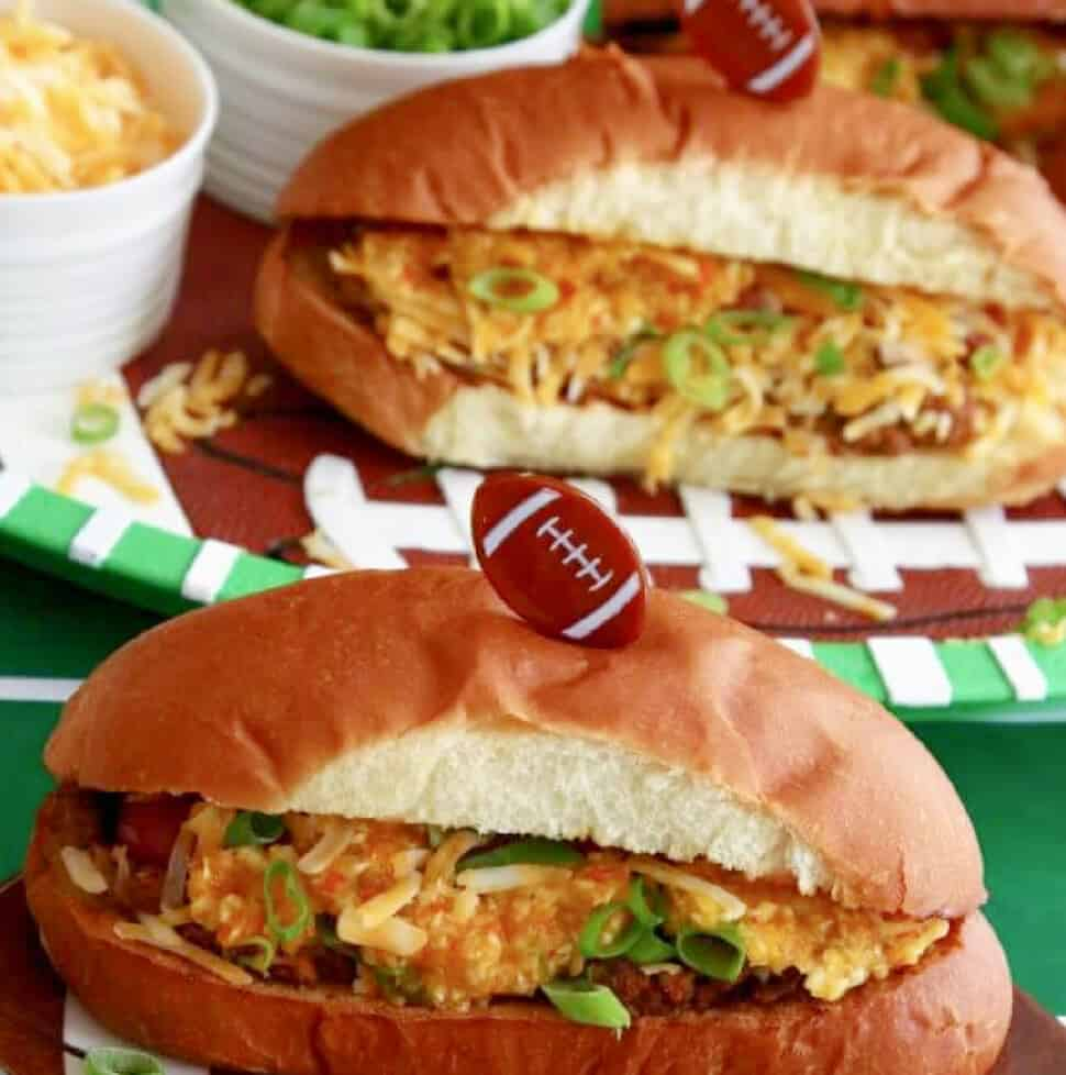 Chili Dogs stuffed with cheese, chili, grated cheese, green onions, and homemade relish.