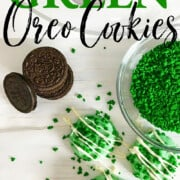 Green chocolate dipped Oreo cookies with green shamrock sprinkles.