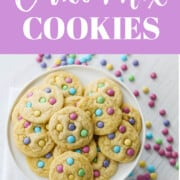An ad showing a white plate filled with bake cake mix cookies dotted with m&m candies.