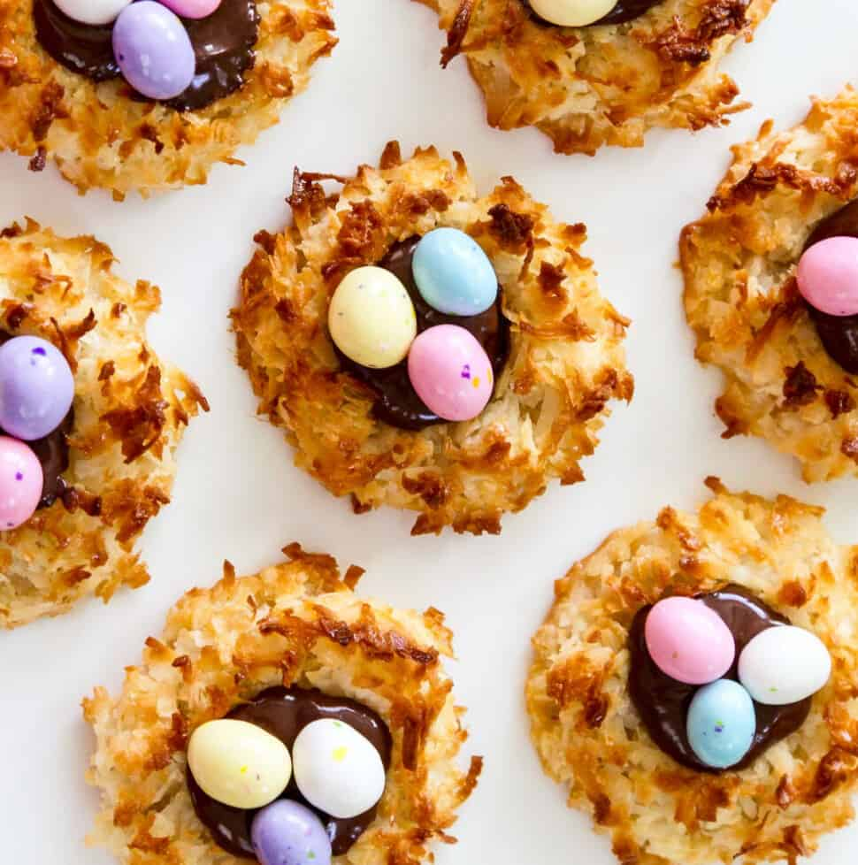 An overhead view of fresh baked and decorated Easter dessert coconut macaroon cookies.