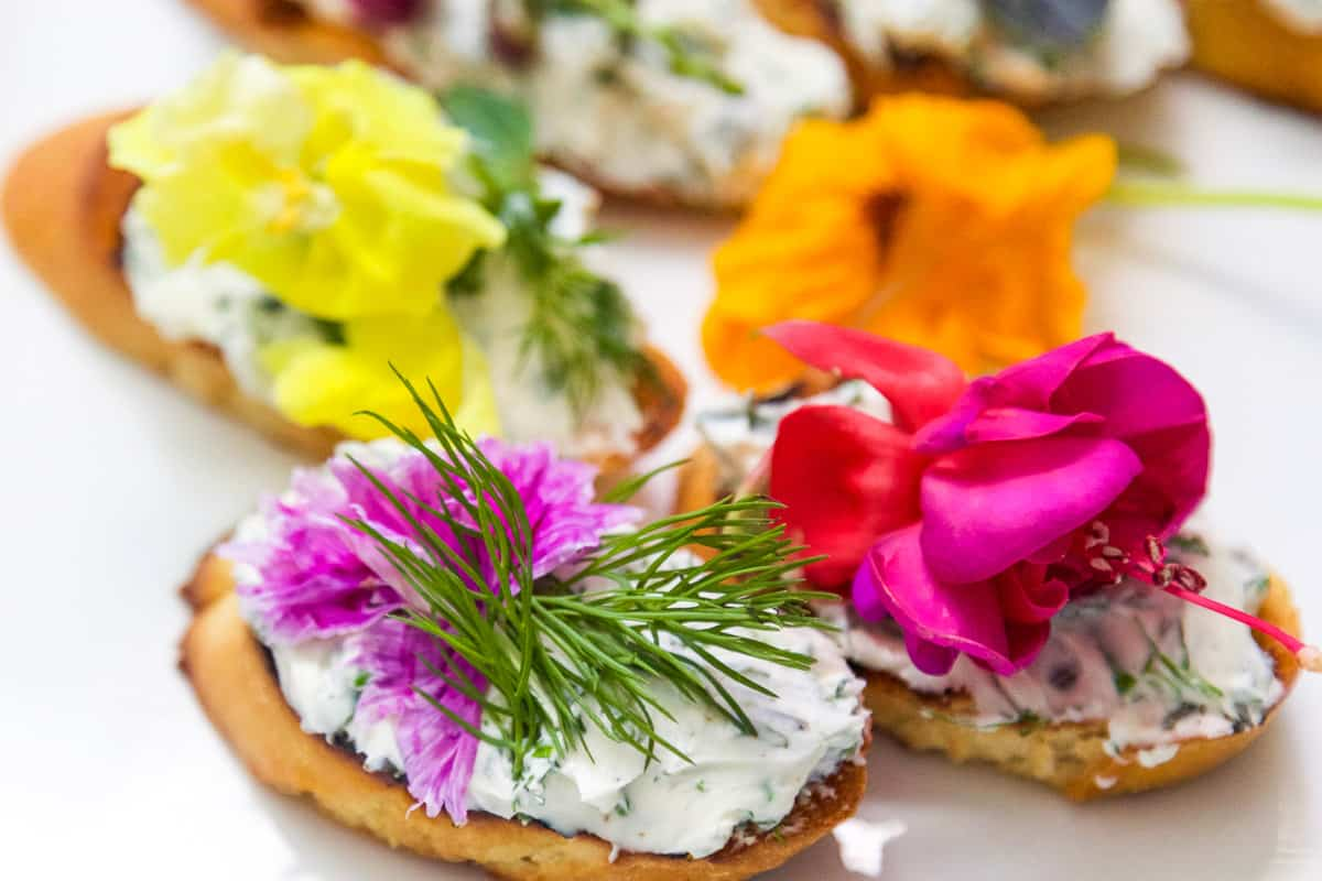 Crostini topped with Cream Cheese Spread and edible flowers.