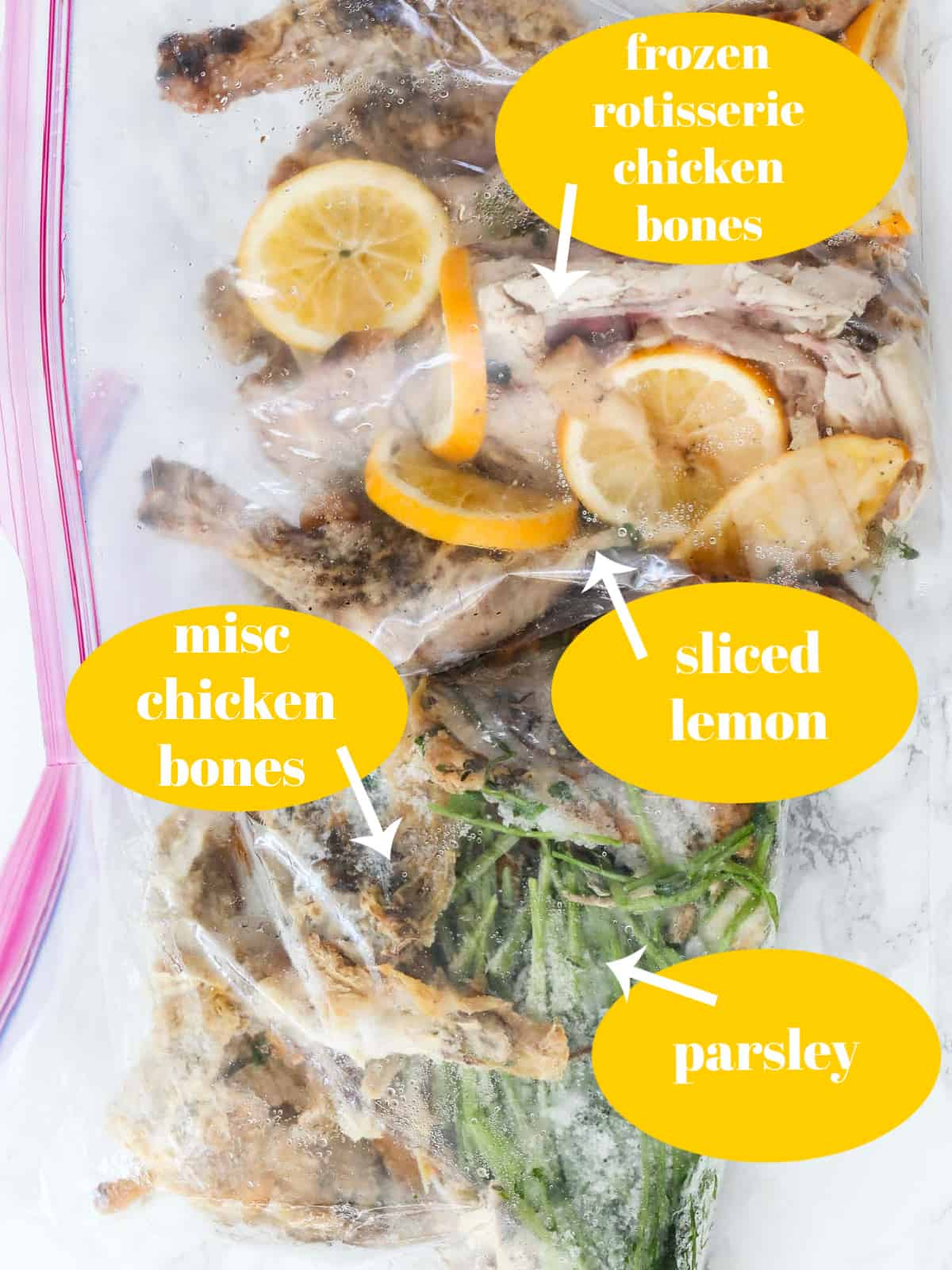 Large freezer bags filled with frozen chicken bones, lemons, and parsley to make chicken stock.