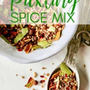 A recipe to make homemade pickling spice in a white bowl.
