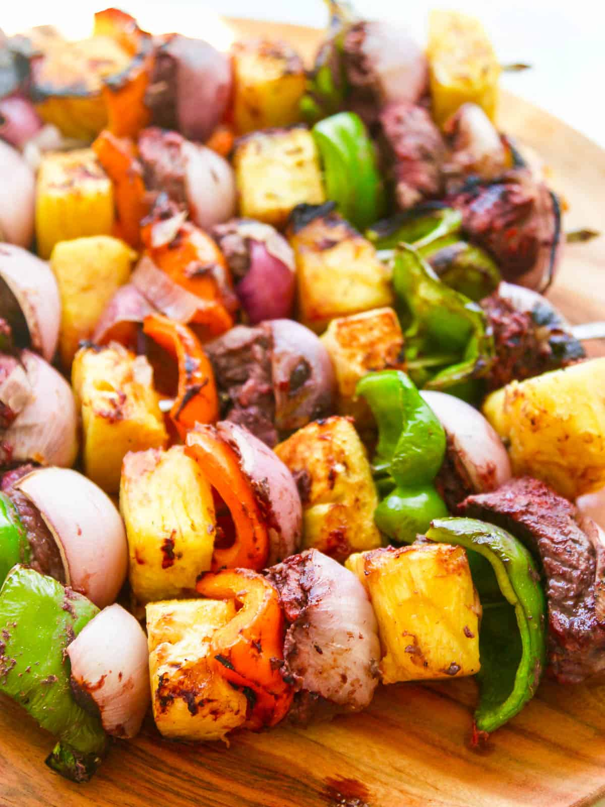Grilled Shish Kebob skewers made with top sirloin beef, bell pepper, pineapple, and onion.