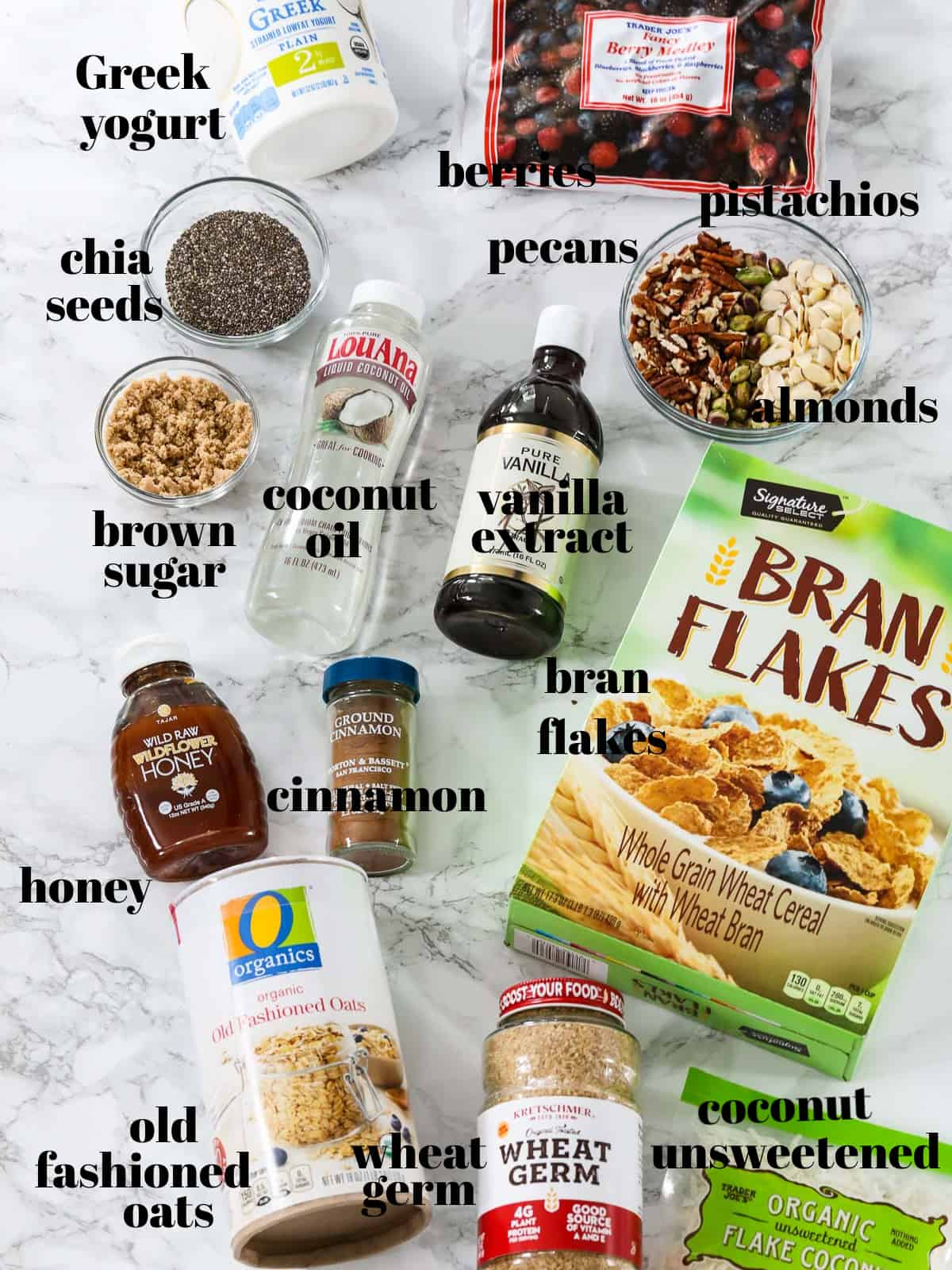 Ingredients labeled to make yogurt parfaits with a granola recipe on a table.