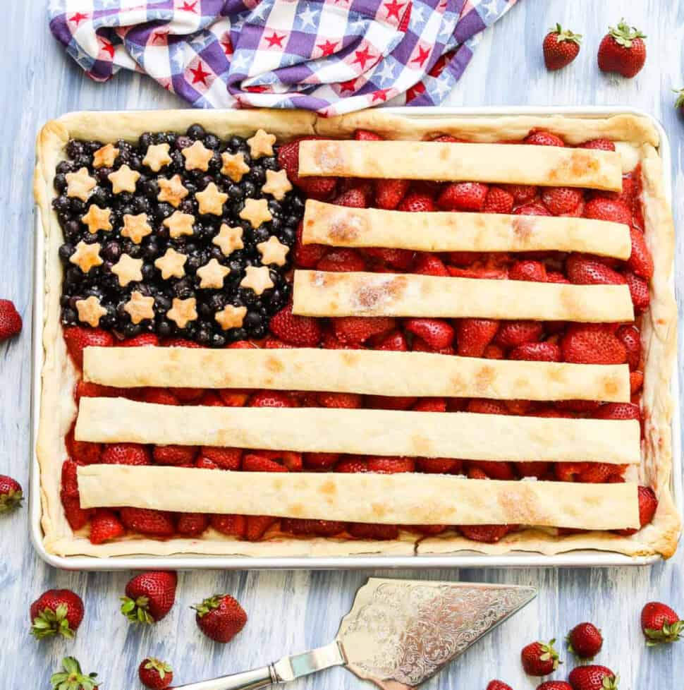 A sheet pan filled with a flag pie made with strawberries, blueberries, and pie crust.