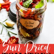 A graphic for a recipe for sun dried tomatoes of them in a small clear jar filled with dried tomatoes and topped with olive oil, rosemary, garlic, and basil for use in recipes.