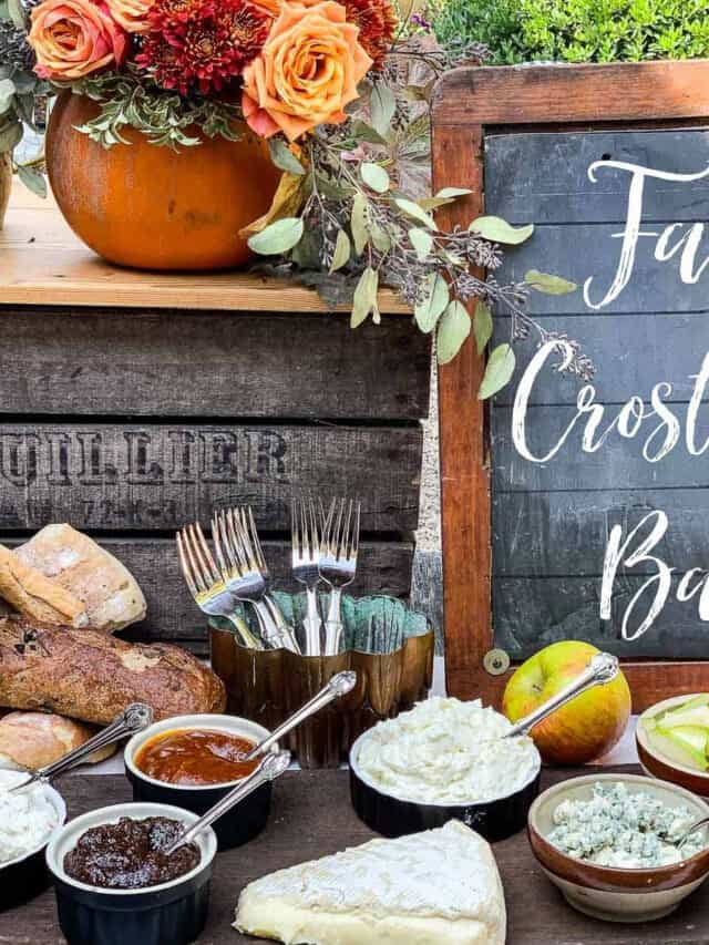 A rustic table with small bowls filled with toppings for a fall appetizer crostini bar.