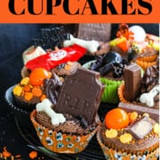 A graphic of Halloween Cupcakes with chocolate frosting, chocolate tombstones, candy, toys, sprinkles, and more.