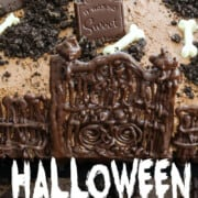 A Halloween cake with chocolate tombstones, crushed oreos for dirt, and white chocolate bones.