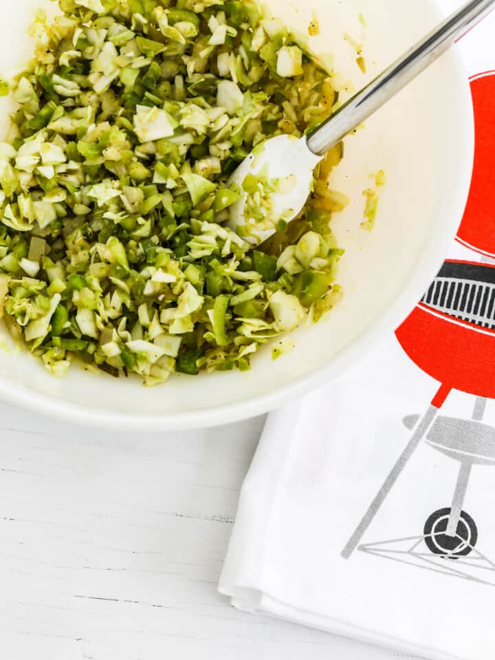 Relish recipe mixed in white bowl with cute bbq towel.