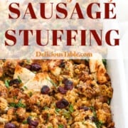 A graphic for Thanksgiving Sausage Stuffing baked in a white ceramic casserole dish.