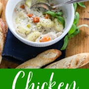 A graphic showing a white bowl filled with Chicken Gnocchi Soup garnished with basil and small bread sticks nearby.